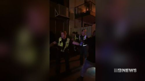 The man who captured the police on camera alleges he was wrongfully arrested after telling officers he had filmed the melee. (9NEWS)