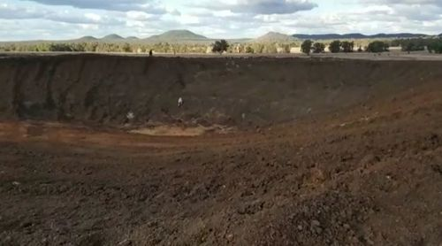 The empty dam on a property owned by mum and farmer Jess Taylor. Picture: 9NEWS