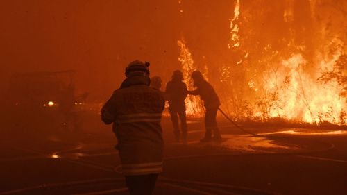Firefighter a second after being hit by a car in thick smoke as fire roared through eastern Bilpin, December 21, 2019.