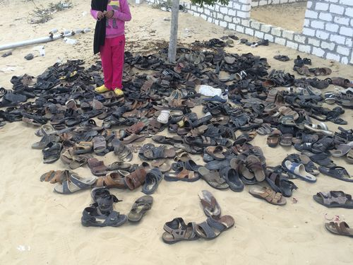 Discarded shoes of victims remain outside Al-Rawda Mosque in Bir al-Abd northern Sinai, Egypt. a day after attackers killed hundreds of worshippers, on Saturday (AP Photo)
