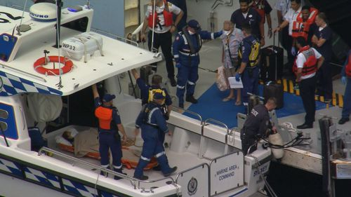 An unwell passenger has been removed from a cruise ship in Sydney Harbour.