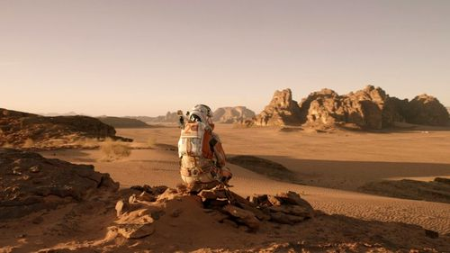 Matt Damon sits on the planet Mars in the movie 'The Martian'.
