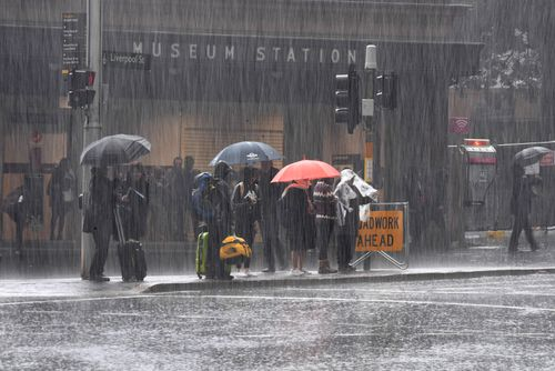 The umbrellas were out in force today in Sydney's CBD as the deluge hit. Picture: AAP