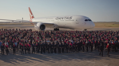 The Qantas ad used real employees for the nostalgic walk through the eras.