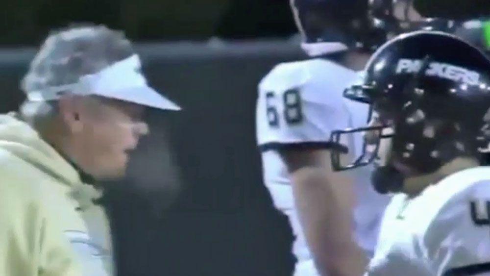 Enraged gridiron coach headbutts own player