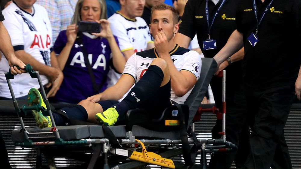 Harry Kane was stretchered from the field. (AAP)