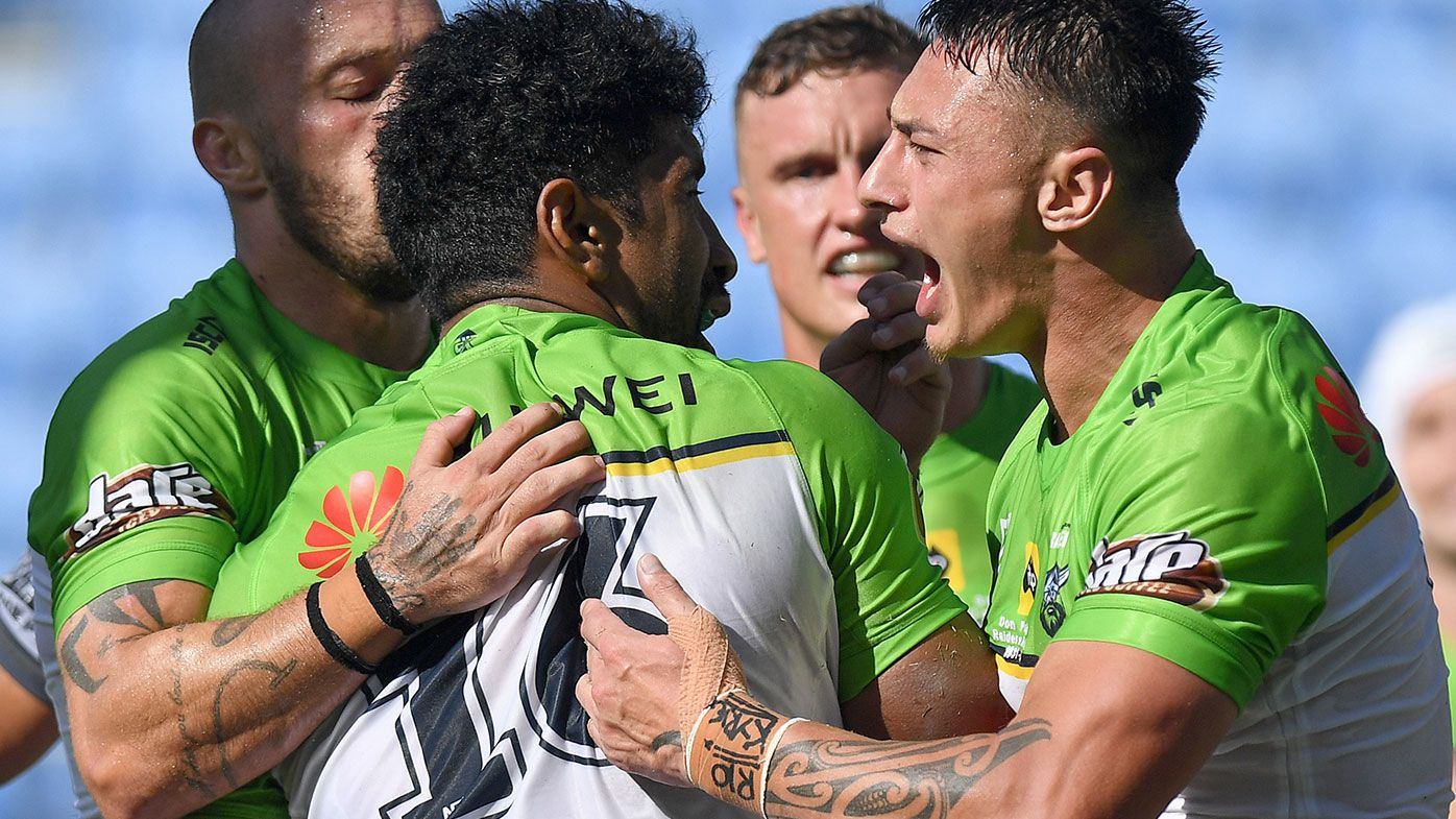 Iosia Soliola of the Raiders is congratulated by team mates after scoring a try during the round 2 NRL match between the New Zealand Warriors