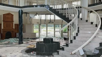 """The multi-million-dollar Nerang mansion, now labelled as a """"disgrace"""" by residents, has had its windows, walls and ceilings smashed and destroyed and is covered in graffiti."""