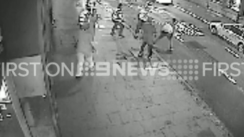 The fight turns dangerous as it spills onto a busy road. (9NEWS)