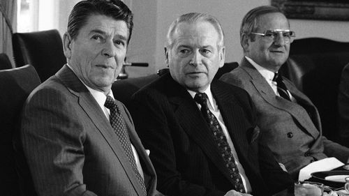 In this 1981 file photo, former US President Ronald Reagan, left, meets with auto industry executives, including Ford President Philip Caldwell, centre, and Chrysler President Lee Iacocca at a luncheon in the White House Cabinet room.