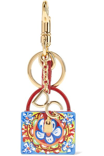 """<a href=""""https://www.net-a-porter.com/au/en/product/1012405/dolce___gabbana/gold-plated--leather-and-printed-resin-keychain"""" target=""""_blank"""" draggable=""""false"""">Dolce & Gabbana Gold-Plated, Leather and Printed Resin Keychain, $345</a>"""