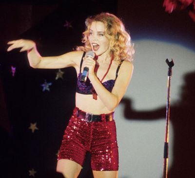 Kylie marrying the 80s bike pants trend with onstage sparkle in the late 80s.