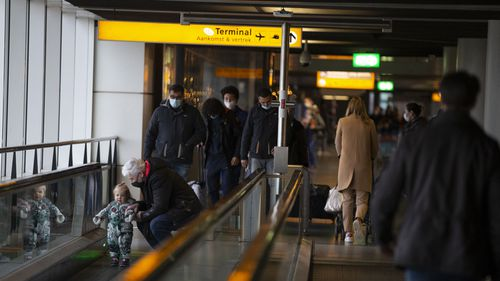 Arriving and departing passengers use the flat escalators at Schiphol Airport, near Amsterdam, Netherlands (Photo: December 18, 2020)