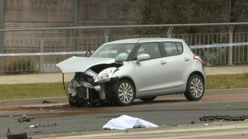 A woman was trapped in the Suzuki Swift before being taken to Liverpool Hospital for treatment.