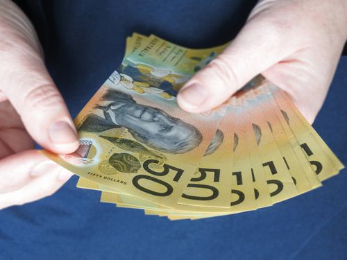 close up person holding cash