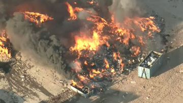 '400 mattresses' go up in flames in massive tip fire