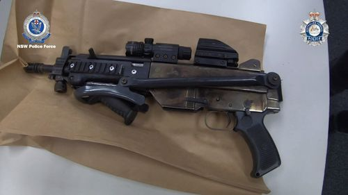 Police seized 14 guns, including military-style rifles, pistols of high calibre and a pump action shotgun.