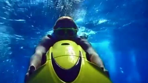The SeaBob motorised scooter can dive underwater. (Supplied)