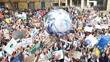 Students outside Sydney Town Hall protest climate change inaction.