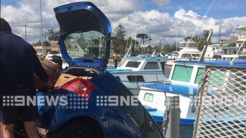 Two elderly women rescued from car dangling off Melbourne jetty