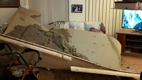 The ceiling collapsed on the couple as they were watching the news. (9NEWS)