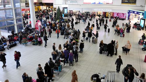 Passengers wait within Gatwick Airport in south London.