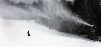 January 15, 2016 - A snowboarder makes his way down Attitash ski area in New Hampshire, USA, where cold temperatures finally brought snow. (AAP)