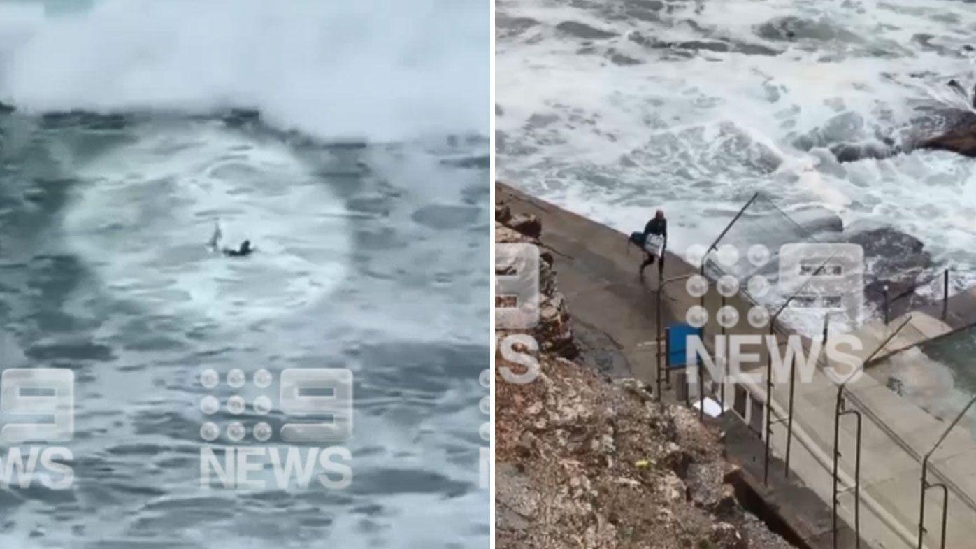 Kelly Slater snaps board in huge swell off Sydney's Avalon Beach. (Nine)