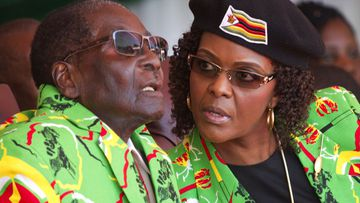 Robert and Grace Mugabe at a Zimbabwean youth rally in June this year. (AAP)