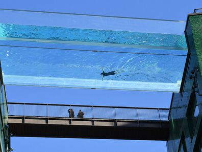 The transparent 25-metre-long outdoor pool, known as the Sky Pool, will allow residents to swim from one building to the other, 10 stories above the ground.