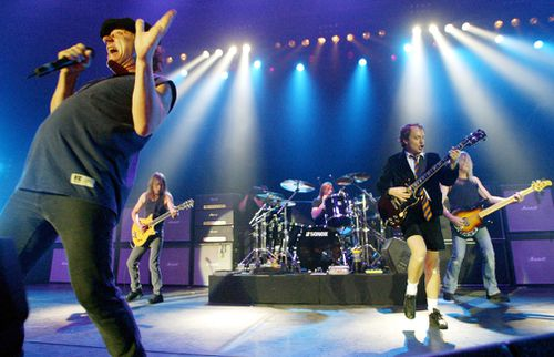 Malcolm Young (back left) performs with AC/DC. (AAP file image)