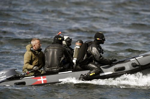 Divers from the Danish Defence Command prepare for a dive in Denmark last year where the torso of Kim Wall was found.
