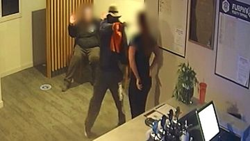 Queensland Police have released new footage of an armed robbery that took place at a hotel north of Brisbane last week, which saw staff threatened with a gun.
