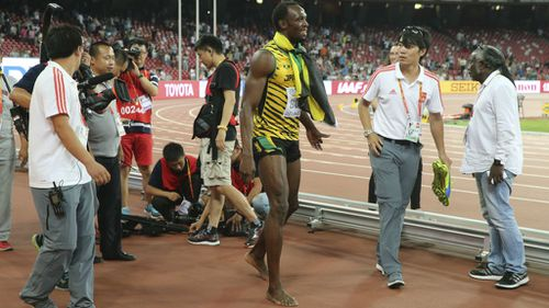 Bolt was uninjured in the accident, and continued his victory lap. (AAP)