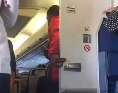 Man emerges from plane bathroom, joins mile high club