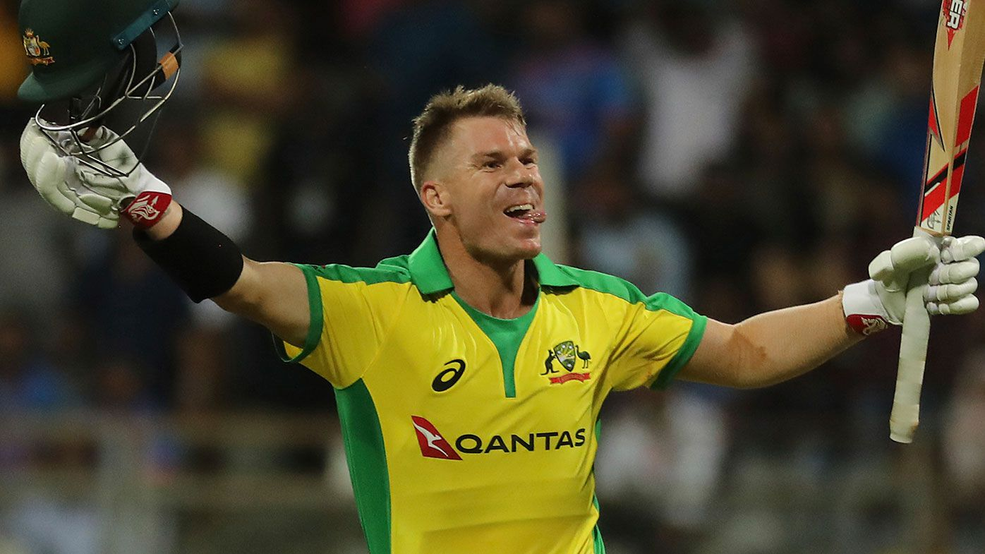 David Warner celebrates his century against India in Mumbai.