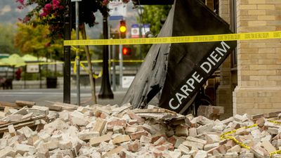 An awning for Carpe Diem wine bar sits among rubble in Napa, Calif., following an earthquake Sunday, Aug. 24, 2014. (AAP)