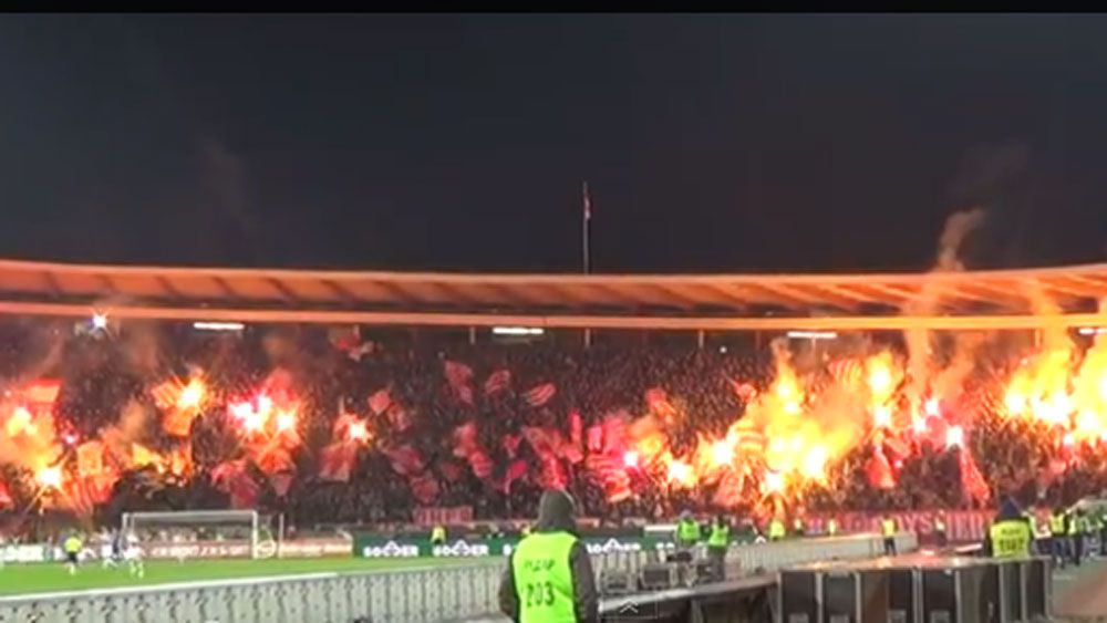 Fans turn Red Star Belgrade's home ground into a fireball. (Supplied)