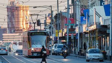A tram headed for Coburg is seen on Sydney Road in Brunswick which is in the council of Moreland in Melbourne on June 29, 2020 in Melbourne, Australia