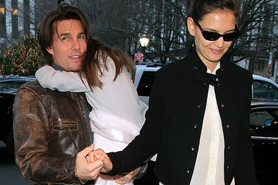Once Suri came along, holding hands in public became a bit trickier.