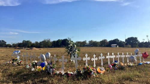 A white cross for each victim has been placed in a field on the outskirts of the town. (Lizzie Pearl)