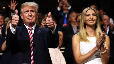 Donald Trump gives two thumbs up at the 2016 Republican National Convention as Ivanka Trump watches on and applauds.