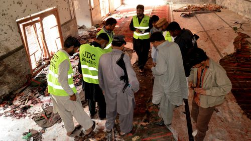 A Taliban splinter terror group claimed responsibility for the attack as officials comb over the site for evidence. (AAP)
