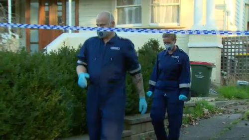 Detectives scouring the scene this afternoon. (9NEWS)
