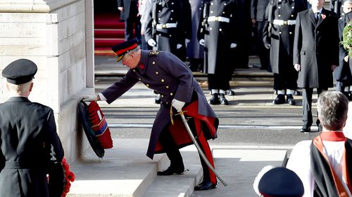 Charles, Prince of Wales, lays a wreath at the Cenotaph during the Remembrance Sunday and Centenary of the Armistice service on Whitehall in London, Britain.