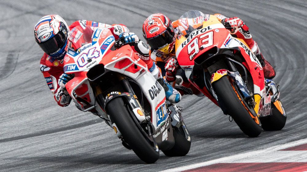 Andrea Dovizioso holds off late challenge from Marc Marquez to win Austrian GP
