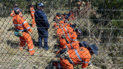 A file photo from 2012 shows SES volunteers and police conducting a search for the body of Patricia Riggs.