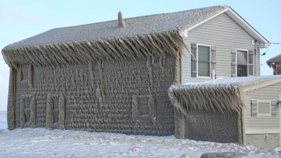 Bizarre ice formations settle on New York state homes