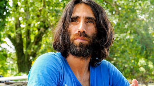 Refugee Behrouz Boochani poses for a photograph on Manus Island in 2017.