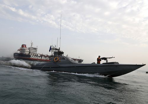 A speedboat of Iran's Revolutionary Guard moves around a British-flagged oil tanker Stena Impero, which was seized on Friday, in the Iranian port of Bandar Abbas. Iranian officials say the seizure of the British oil tanker was a justified response to Britain's role in impounding an Iranian supertanker two weeks earlier off the coast of Gibraltar, a British territory located on the southern tip of Spain.